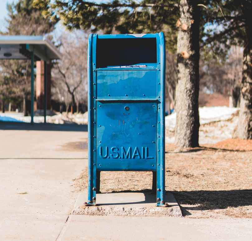 A picture of a blue mailbox. Photo taken by Alex Perz.