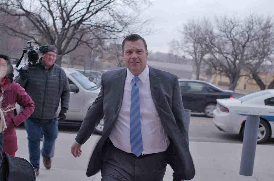 Kris Kobach walking outside